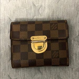 Louis Vuitton trifold wallet with red interior